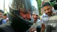 Greece's Varoufakis bids farewell, leaves on motorbike