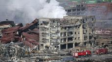China: Huge blast site too risky for firemen