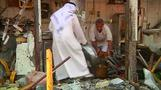 Iraqis clean up after deadly bo
