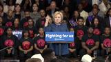 Clinton targets health care costs, guns