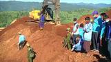 Searchers look for Myanmar landslide bodies