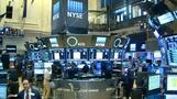 Dow crosses 18,000