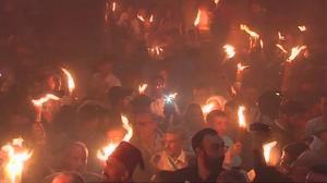 Thousands mark Greek Orthodox Holy Fire rite in Jerusalem