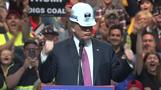 Trump dons miner's hat in coal country