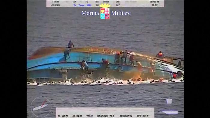 Dramatic video of migrant ship rocking, capsizing
