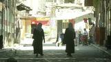 As war rages in Syria; Restoration begins in Homs