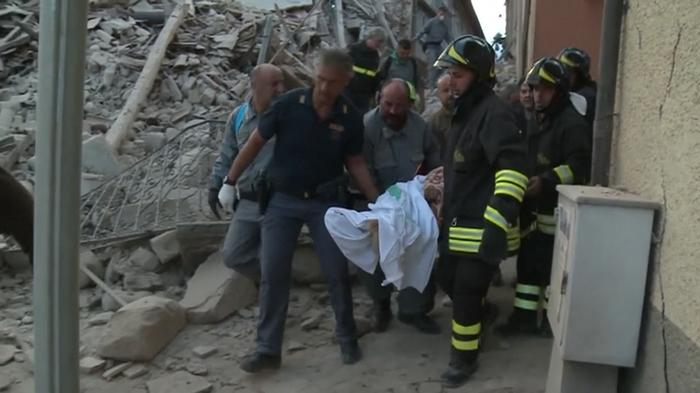 'Voices under the rubble' as Italy quake death toll rises
