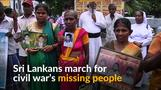 Families of people missing in Sri Lanka's civil war march in silence