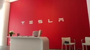 Tesla surprises with quarterly profit