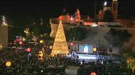 Palestinians light up Christmas tree in Bethlehem