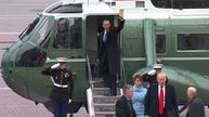 Obamas fly off as Trump begins presidency