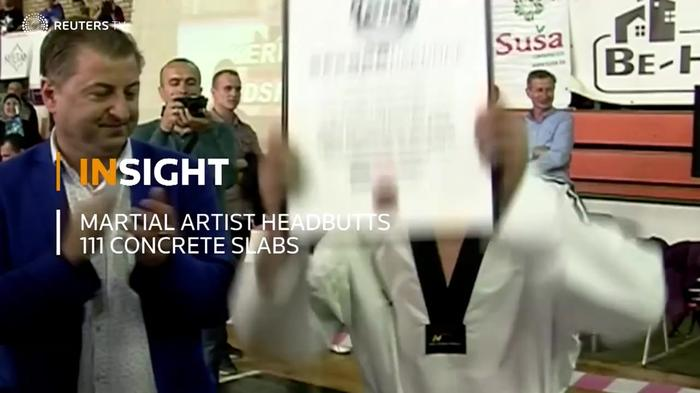 INSIGHT: Martial artist headbutts 111 concrete slabs