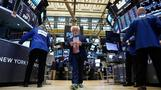 Wall Street rallies on earnings