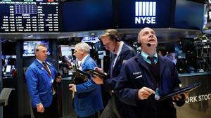 Wall Street dips on tax uncertainty