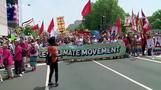 Climate protesters march through Washington as Trump marks milestone