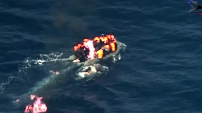 Migrants rescued from burning boat
