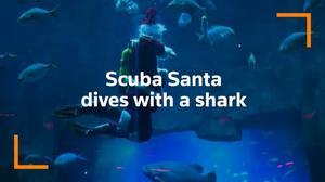 Scuba-diving Santa Claus teaches kids about climate change