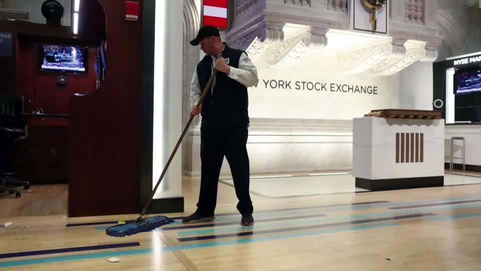 Wall Street sinks as coronavirus fear grows