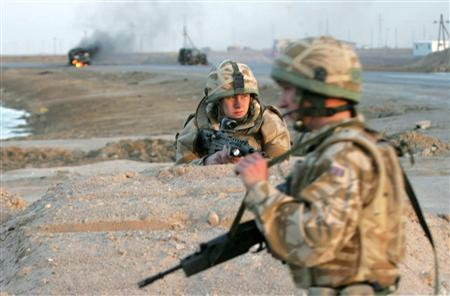 British soldiers secure the scene of a bomb attack that targeted their patrol south of Basra, 550 km (340 miles) south of Baghdad, December 29, 2006. A study of military veterans suffering from post-traumatic stress disorder found the more severe their anxiety, the greater their risk of heart disease, researchers said on Monday. REUTERS/Atef Hassan
