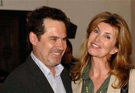 Comedian Dennis Miller (L) arrives with his wife Carolyn at the 21st Santa Barbara International Film Festival at the Arlington Theatre in Santa Barbara, California, February 12, 2006. Miller plans in March to launch his first radio show on Westwood One Inc.'s network, the company said on Wednesday. REUTERS/Phil Klein