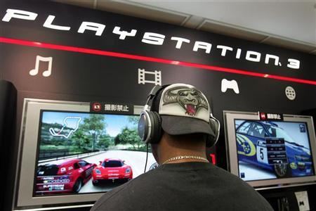 A man tries out the new PlayStation 3 video game console at a Sony showroom in Tokyo November 6, 2006. Video game addicts, rejoice: U.S. researchers have found that playing is actually good for your eyes, and despite all those dire warnings from your parents, it won't make you blind. REUTERS/Toshiyuki Aizawa