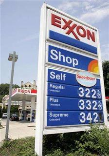 A sign displays prices at a gas station in Washington July 27, 2006. Surging oil prices have brought energy companies record profits in recent years. But the boom has also pushed up the cost of doing business and emboldened oil-producing nations to restrict access to their reserves. REUTERS/Yuri Gripas