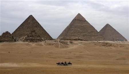 Tourists ride horses in front of the Giza pyramids on the outskirts of Cairo January 7, 2007. What are the greatest architectural achievements in history? Rome's Colosseum? The Great Wall of China? The Pyramids of Giza? That's what millions of people are asking themselves as they vote in the largest global poll ever conducted, an attempt to recast ancient history by ranking the top architectural marvels as the ''new'' seven wonders of the world. REUTERS/Goran Tomasevic