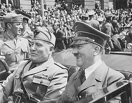 Mussolini and Hitler are seen in Munich Germany in a 1940 photo from the National Archives. Small packets of sugar bearing the likeness of Adolf Hitler and carrying Holocaust jokes have been found in some cafes in Croatia, prompting an investigation, the office of the state prosecutor said Monday. REUTERS/National Archives/Handout
