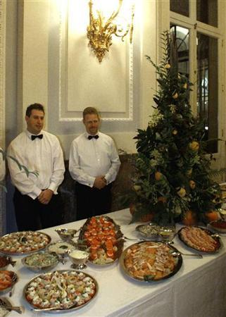 Waiters stand behind a buffet in an undated file photo. A jobless German has been handed a five-month suspended jail term for stealing a buffet for 60 people and eating it with friends, authorities said on Tuesday. REUTERS/Yves Herman