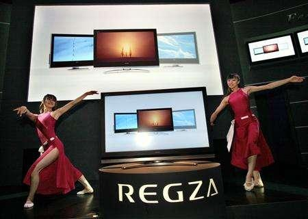 Models perform next to a TV at the CEATEC Japan exhibition in Makuhari, northeast of Tokyo October 3, 2006. Last week a U.S. court ruled against Canon, saying the company breached its deal with Nano-Proprietary by trying to share the flat display technology with Toshiba Corp. REUTERS/Toshiyuki Aizawa