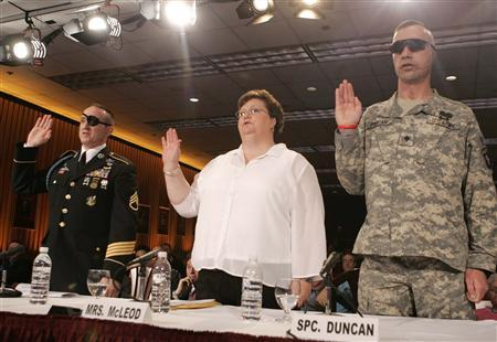 Mrs. Annette McCloud (C), wife of a wounded U.S. Army soldier, wounded U.S. Army Sergeant John Daniel Shannon (L) and wounded U.S. Army Specialist Jeremy Duncan swear in before testifying before a U.S. House subcommittee in Washington March 5, 2007. Problems over treatment of wounded soldiers that created a scandal at the top U.S. military veterans' hospital are prevalent throughout the Army's health care system, lawmakers said on Monday. REUTERS/Larry Downing