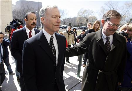 Former Bush White House aide Lewis ''Scooter'' Libby (C) exits the U.S. Federal Courthouse with his attorneys William Jeffress Jr., (R) and Theodore B. Wells (L) after he was convicted of four federal crimes at the U.S. Federal Courthouse in Washington, March 6, 2007. No one is likely to face criminal charges for actually leaking CIA secrets even after a U.S. jury found Libby guilty of lying and obstructing a probe into the affair. REUTERS/Jim Bourg