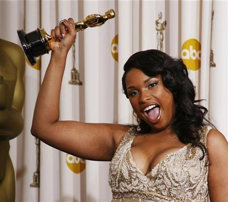 Jennifer Hudson, winner of the Academy Award for Best Supporting Actress for her work in ''Dreamgirls,'' reacts with her Oscar backstage at the 79th Annual Academy Awards in Hollywood, California, February 25, 2007. REUTERS/Mike Blake