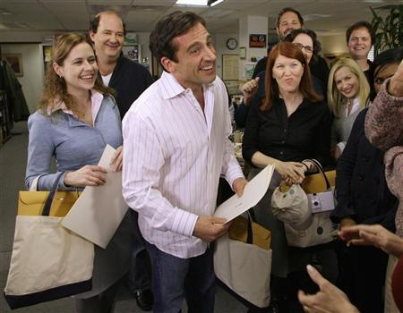 A file photo of actor Steve Carell (C) and other members of ''The Office'' cast including Jenna Fischer (L) on the set of the television show ''The Office,'' in Panorama City, California, January 11, 2007. NBC Universal said on Wednesday it will sell prime-time television shows like ''The Office'' and ''Heroes'' on demand over cell phone networks in the United States. REUTERS/Danny Moloshok