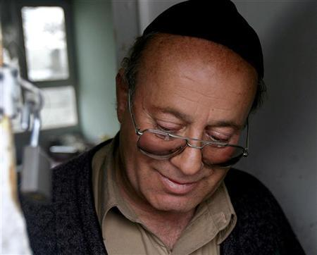 Zebolan Simanto, the last Jew in Afghanistan, at his residence in Kabul, January 26, 2005. Every spring Simanto receives a care package from New York City. Simanto uses the matzos, grape juice and oil sent by New York's Afghan Jewish community to conduct the Seder, a meal eaten on the first evening of the Passover holiday to commemorate the enslavement of the Jews in ancient Egypt and their later escape into freedom. REUTERS/Ahmad Masood