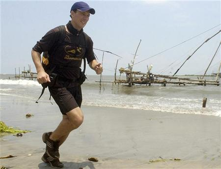 In this file picture, Robert Garside runs on a beach in Kochin City, in the southern Indian state of Kerala 20, April, 2003. More than three years after he finished an epic journey across six continents, Garside has been officially recognised as the first person to run around the world. REUTERS/Dipak Kumar