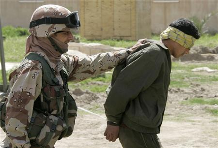 An Iraqi army soldier escorts an arrested young man at a joint security station in Baghdad's northwest Sunni neighborhood of Ghazaliyah, March 26, 2007. REUTERS/Fabrizio Bensch