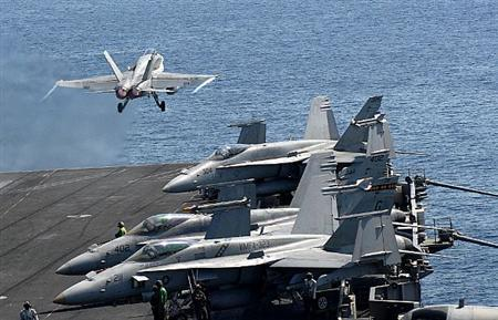 An F/A-18C Hornet launches from Nimitz-class aircraft carrier USS John C. Stennis in the Arabian Sea, March 16, 2007. REUTERS/U.S. Navy/Handout
