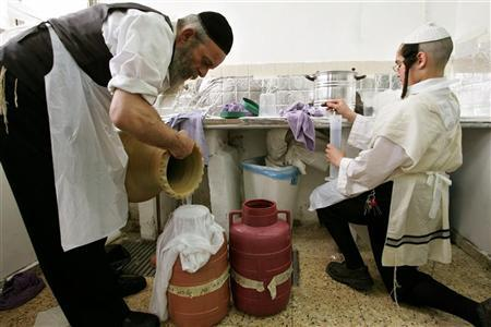 A man prepares water for matza to be eaten during the festival of Passover, in a Jerusalem bakery in a file photo. Marijuana is not kosher for Passover, a pro-cannabis advocacy group says, advising Jews who observe the week-long holiday's special dietary laws to take a break from smoking the weed. REUTERS/Gil Cohen Magen