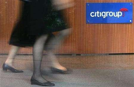 Women walk past the logo of Citigroup at the Citibank tower in Hong Kong in this January 19, 2006, file photo. Citigroup is looking for acquisitions in Germany and could swoop on a big bank, its local head told Reuters in an interview. REUTERS/Paul Yeung