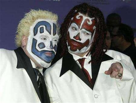 Members of the Insane Clown Posse pose as they arrive at the 2003 Billboard Music Awards at the MGM Grand Garden Arena in Las Vegas, Nevada, December 10, 2003. Despite the No. 20 debut on the U.S. album charts by Insane Clown Posse's new disc, the principal player in the Detroit-based rock/rap hybrid knows what is about to happen. REUTERS/Fred Prouser