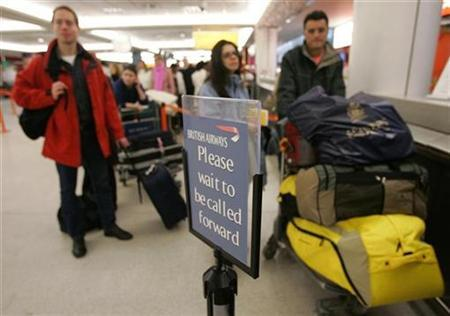 British Airways passengers wait to hear information on flights to Heathrow at Edinburgh Airport, December 21, 2006. British Airways had the worst record among major European airlines for mislaying passenger baggage last year, figures on Wednesday showed. REUTERS/David Moir
