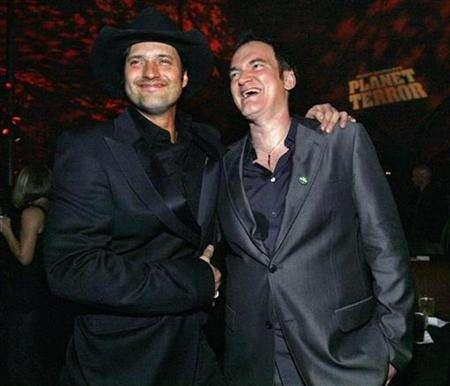 Directors Quentin Tarantino (R) and Robert Rodriguez pose at the after-party for the premiere of ''Grindhouse'' at the Orpheum theatre in Los Angeles March 26, 2007. Tarantino has always been a huge fan of B-movies, that juicy layer of popular culture dominated by zombies, psychotic killers, violent car chases and buckets of gore. REUTERS/Mario Anzuoni