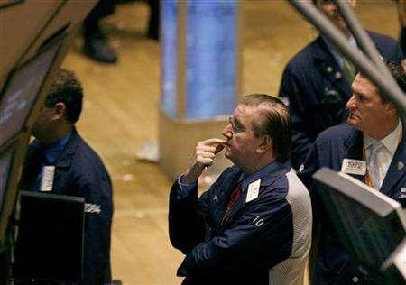 Traders work on the main trading floor of the New York Stock Exchange near the close in the trading session in New York March 13, 2007. REUTERS/Lucas Jackson