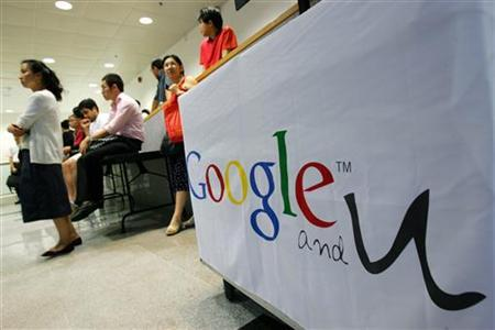 Students inside a campus watch the live broadcast of Lee Kai-fu, vice-president of Google Inc. and co-president of Google China, holding a talk at the University of Hong Kong in this file photo from September 14, 2006. Google Inc. has broken into radio with a multi-year advertising sales agreement with the largest U.S. broadcaster, Clear Channel Radio, the companies said on Sunday. REUTERS/Bobby Yip