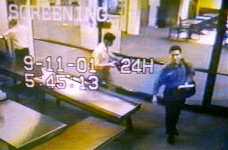 Two men identified by authorities as Mohammed Atta (R) and Abdulaziz Alomari (C) pass through airport security, September 11, 2001. French secret services produced nine reports between September 2000 and August 2001 looking at the al Qaeda threat to the United States, and knew it planned to hijack an aircraft, the French daily Le Monde said on Monday. REUTERS/Portland Police Department/Handout