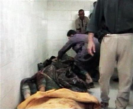 An image taken from footage shot on November 19, 2005 shows bodies after an incident in Haditha. Charges have been dropped against one of the eight U.S. Marines accused in the killing of 24 Iraqi civilians in Haditha and he has been granted immunity for his testimony, the Marine Corps said on Tuesday. REUTERS/Reuters TV/files