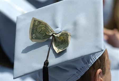 A graduate in a file photo. A dramatic pay gap emerges between women and men in America the year after they graduate from college and widens over the ensuing decade, according to research released on Monday. REUTERS/File
