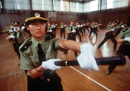 A file photo of female police officers undergoing training at an academy in Beijing. Chinese tourism authorities are seeking investment to build a novel concept attraction -- the world's first ''women's town,'' where men get punished for disobedience, an official said Thursday. REUTERS/Stringer