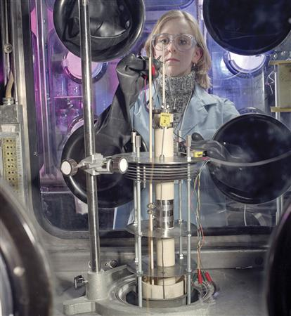 A laboratory researcher tests a nuclear fuel treatment process at Argonne National Laboratory in Illinois in this 2003 file photo. The U.S. government, energy experts and even some environmentalists see a revival of nuclear power as a clean energy alternative, but that resurgence may be held up by a lack of qualified workers. REUTERS/Argonne National Laboratory/George Joch/Handout